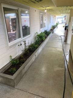 Covered walkway with planters